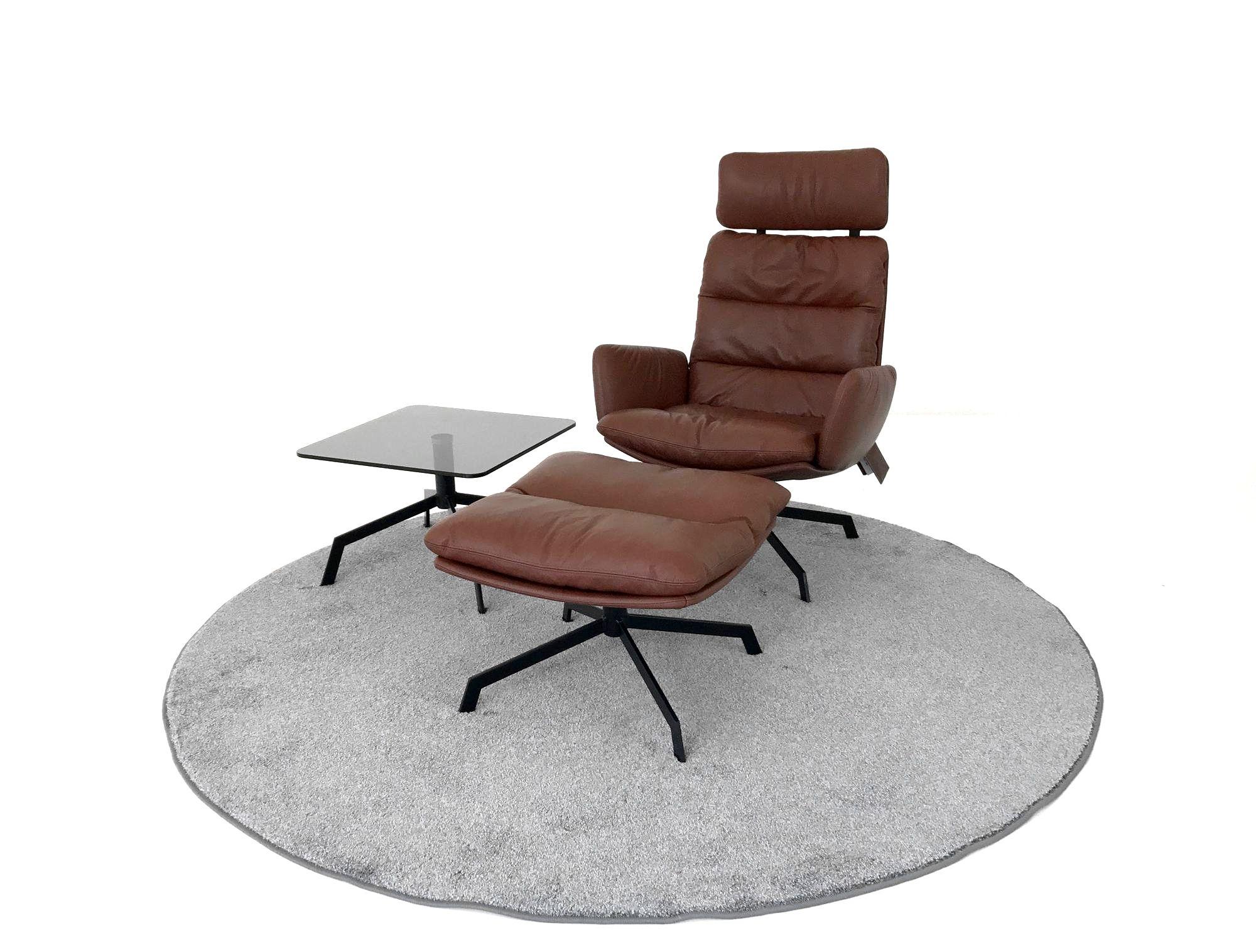 kff arva lounge drehsessel und hocker in leder sauvage. Black Bedroom Furniture Sets. Home Design Ideas